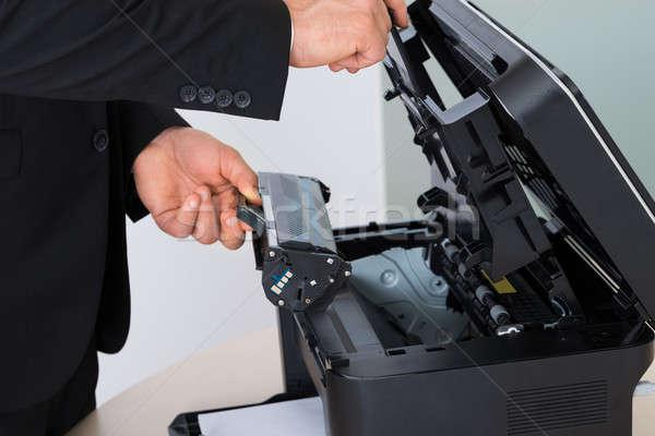 üzletember megjavít patron gép iroda férfi Stock fotó © AndreyPopov