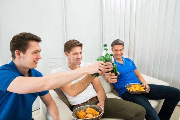 Three Male Friends Having Party Stock photo © AndreyPopov