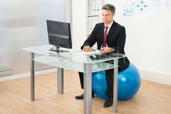 Imprenditore lavoro ufficio seduta pilates palla Foto d'archivio © AndreyPopov