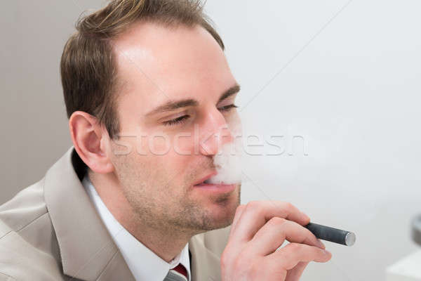 Businessman Smoking Electronic Cigarette Stock photo © AndreyPopov