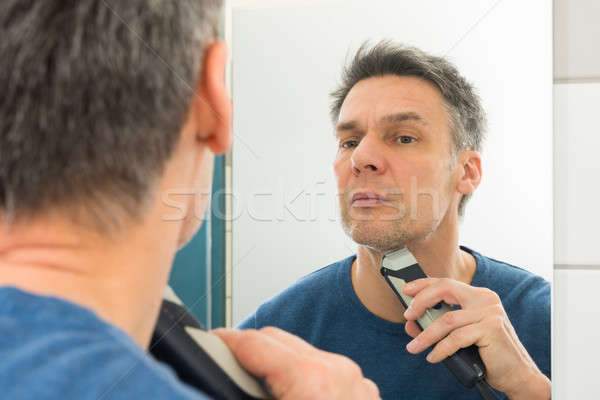 Man Trimming Beard Stock photo © AndreyPopov