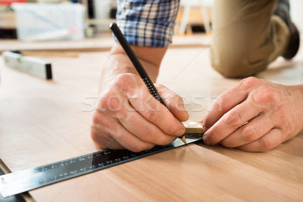 Worker Drawing A Mark On Laminate Using Ruler Stock photo © AndreyPopov