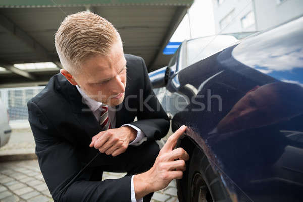 Man Looking For Scratches On His Car Stock photo © AndreyPopov