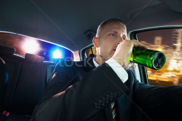 Man Drinking Beer Chased By Police Stock photo © AndreyPopov