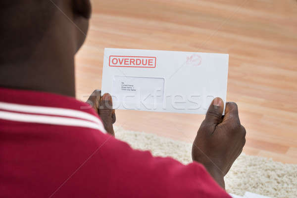 Man Holding Overdue Notice Stock photo © AndreyPopov