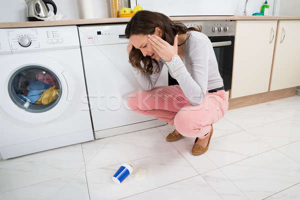 Woman Looking At Yoghurt Fallen On The Floor Stock photo © AndreyPopov