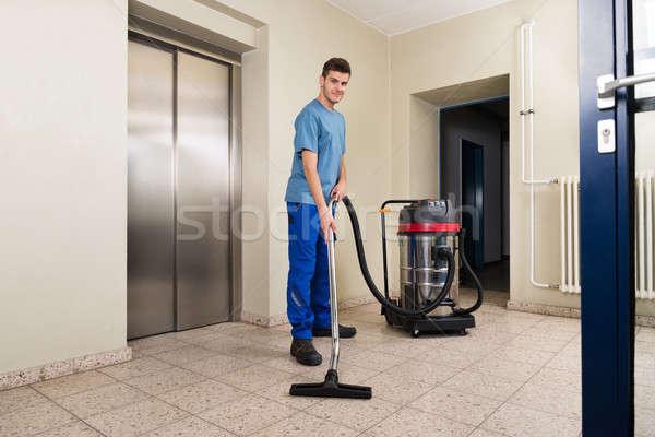 мужчины работник очистки пылесос счастливым полу Сток-фото © AndreyPopov