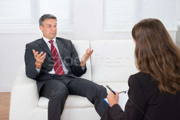 Patient Talking With Psychiatrist Stock photo © AndreyPopov