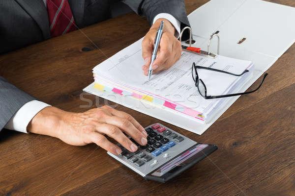 Buchhalter Rechnung Rechner Schreibtisch grau Papier Stock foto © AndreyPopov