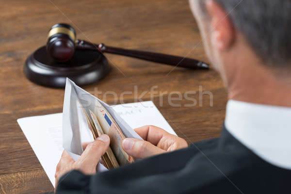 Judge Counting Money In Envelop At Table Stock photo © AndreyPopov