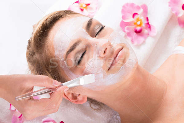 Beautician Applying Mask On Customer's Face At Salon Stock photo © AndreyPopov