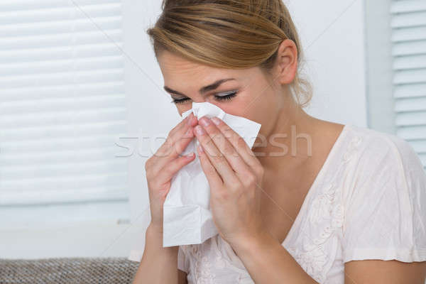 Woman Blowing Nose While Suffering From Cold Stock photo © AndreyPopov
