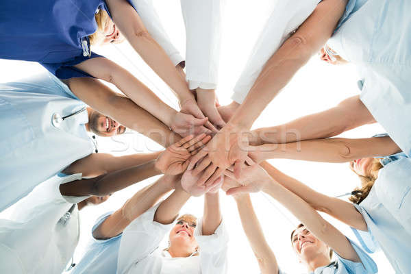Multiethnic Medical Team Stacking Hands Stock photo © AndreyPopov