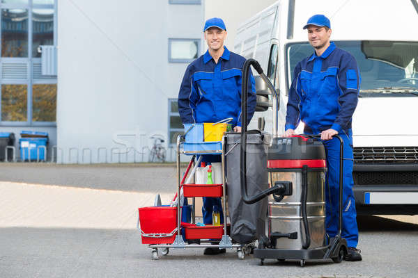 Confident Male Janitors Standing On Street Stock photo © AndreyPopov