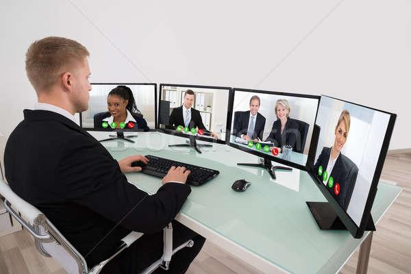Businessman Video Conferencing On Desk Stock photo © AndreyPopov