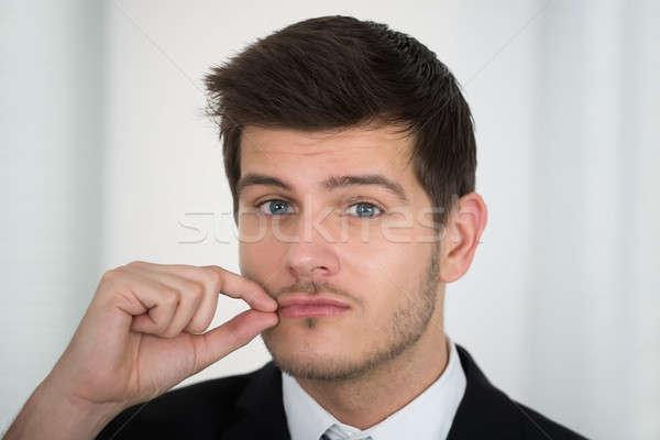 Empresário boca zíper silêncio escritório Foto stock © AndreyPopov