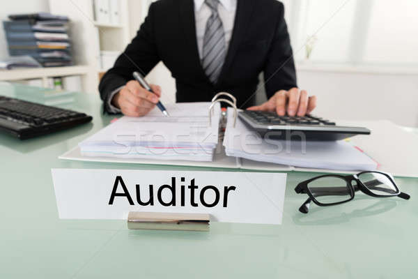 Male Auditor Calculating Bill Stock photo © AndreyPopov