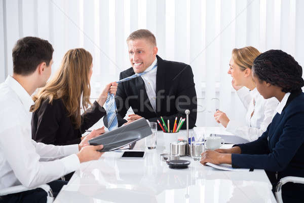 Two Businesspeople Quarreling In Meeting Stock photo © AndreyPopov