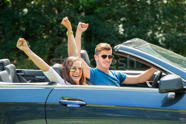 Couple Sitting In A Car Wearing Sunglasses Stock photo © AndreyPopov
