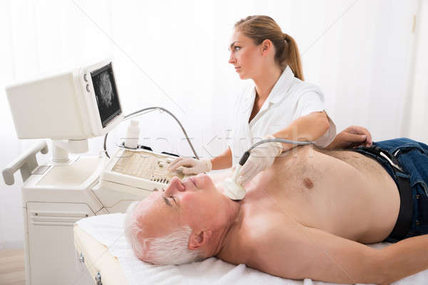 Man Getting Ultrasound Scan On Neck By Doctor Stock photo © AndreyPopov