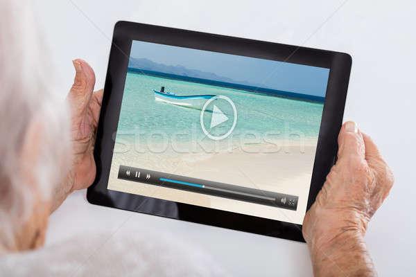 Senior Woman Watching Video On Digital Tablet Stock photo © AndreyPopov