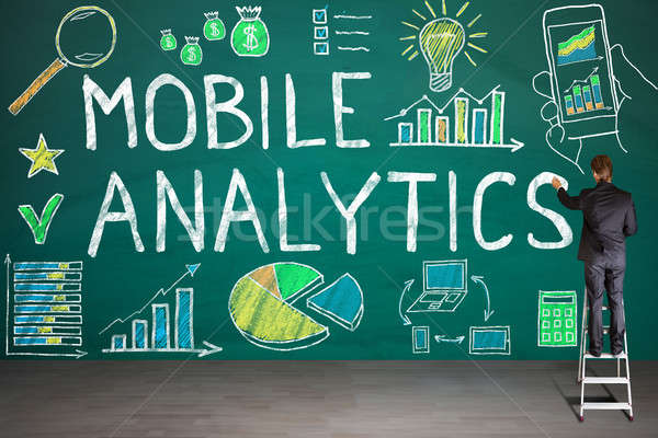 Zakenman tekening mobiele analytisch Blackboard analytics Stockfoto © AndreyPopov