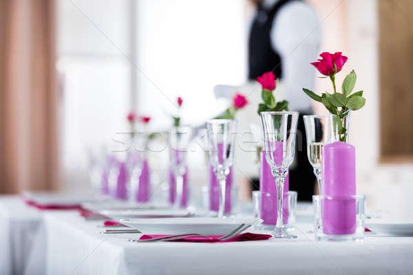 Pincér áramló pezsgő üveg közelkép rózsa Stock fotó © AndreyPopov