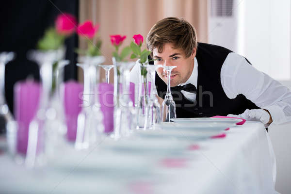 Waiter Looking At Table Arrangement Stock photo © AndreyPopov
