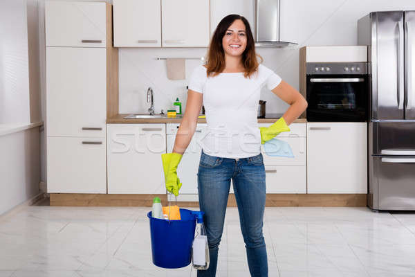Happy Woman Using Cleaning Equipment In Kitchen Stock photo © AndreyPopov