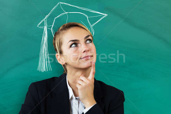 Businesswoman Thinking Of Completing Education Stock photo © AndreyPopov