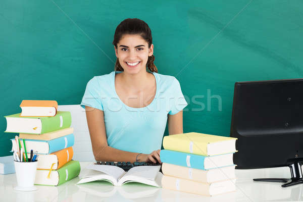 Portrait Of Woman Studying On Desk In Classroom Stock photo © AndreyPopov