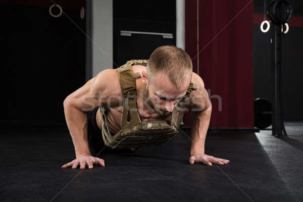 Young Bodybuilder Doing Push-ups Stock photo © AndreyPopov