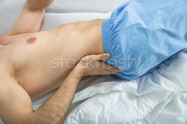 Man Suffering From Back Pain At Home Stock photo © AndreyPopov