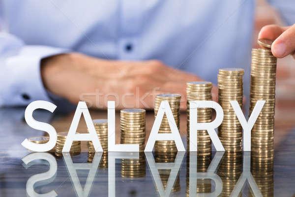 Salario texto monedas persona moneda Foto stock © AndreyPopov