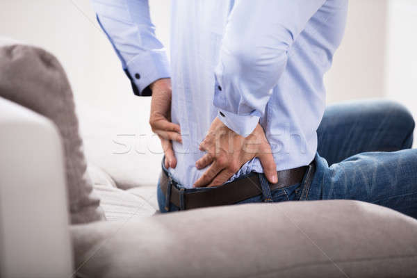 Person Suffering From Backache At Home Stock photo © AndreyPopov
