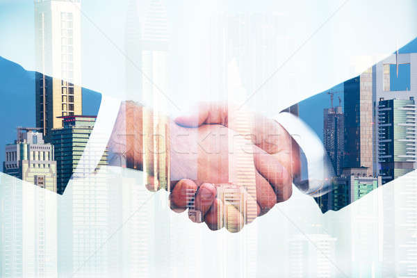 Business People Shaking Hands Over City Background Stock photo © AndreyPopov