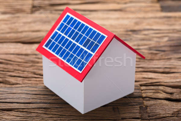 Solar Panel On Model Home At Table Stock photo © AndreyPopov