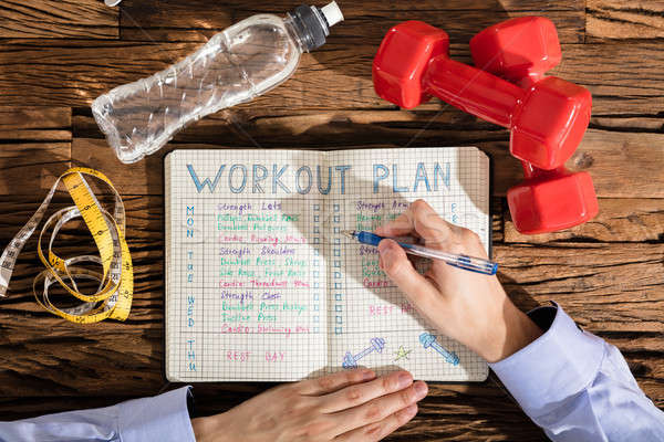 Stock foto: Person · beachten · Training · Plan · Notebook