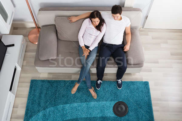 Couple Using Cleaner Robot Stock photo © AndreyPopov