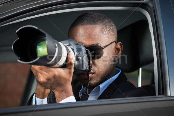 Detective Sitting Inside Car Photographing Stock photo © AndreyPopov