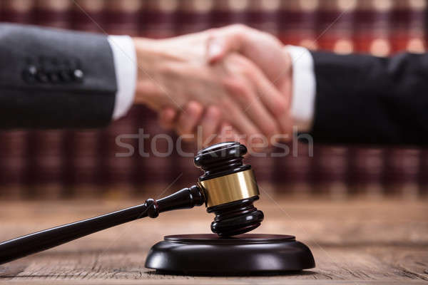 Judge Shaking Hand With Client Stock photo © AndreyPopov