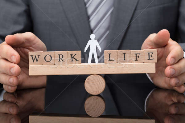 Businessperson Protecting Balance Between Life And Work Stock photo © AndreyPopov