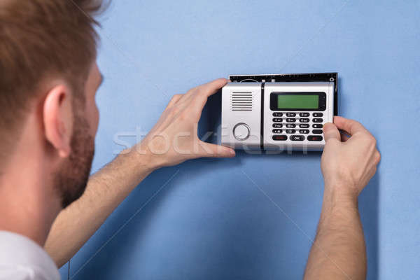 Human Hand Installing Security System Stock photo © AndreyPopov