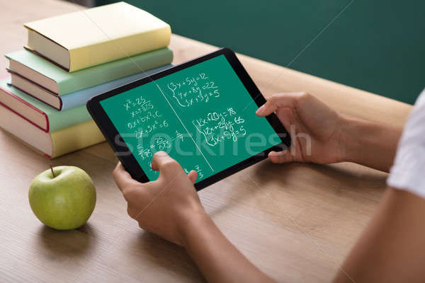 Human Hand Solving Math Problems On Digital Tablet Stock photo © AndreyPopov