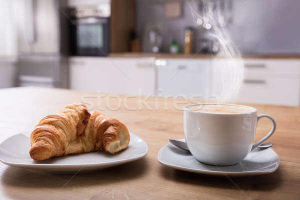 Croissant And Cup Of Coffee At Breakfast Stock photo © AndreyPopov