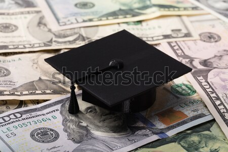 Graduation Cap On Dollar Banknotes Stock photo © AndreyPopov