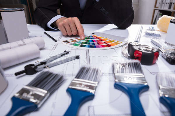 Stock photo: Architect's Hand Choosing Color From Swatch