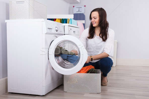 Woman Loading Clothes In Washing Machine Stock photo © AndreyPopov