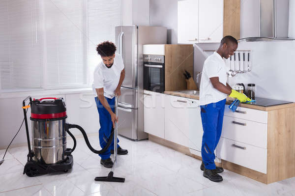 Two Male Janitor Cleaning The Kitchen Stock photo © AndreyPopov