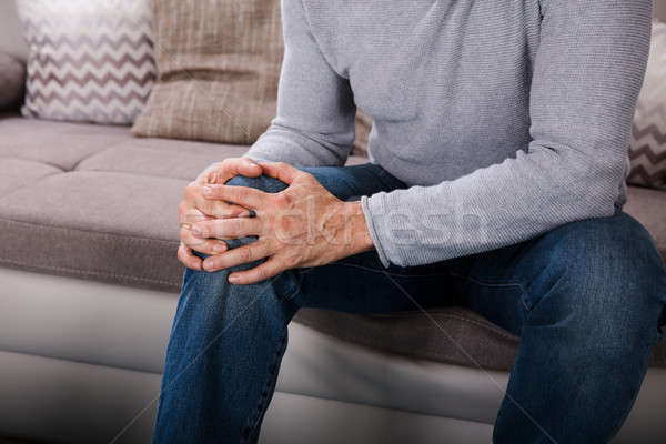 Man Suffering From Knee Pain Stock photo © AndreyPopov